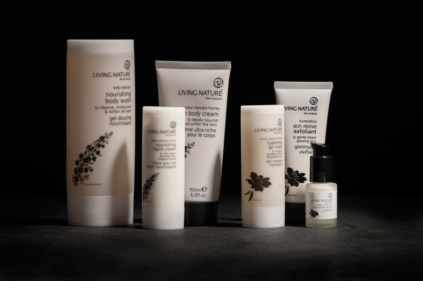 A variety of Living Nature beauty products are displayed without their boxes