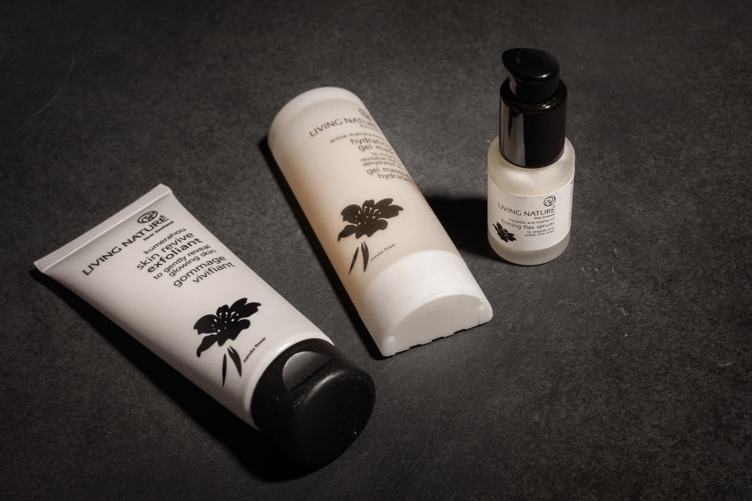 Three Living Nature beauty products are displayed without their boxes