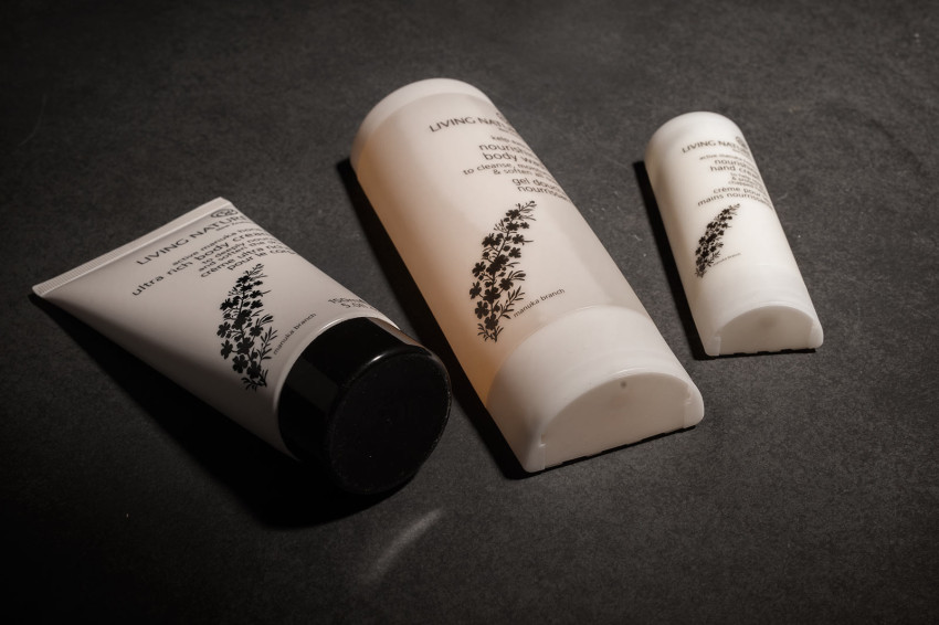 Three Living Nature beauty products are displayed flat without their boxes