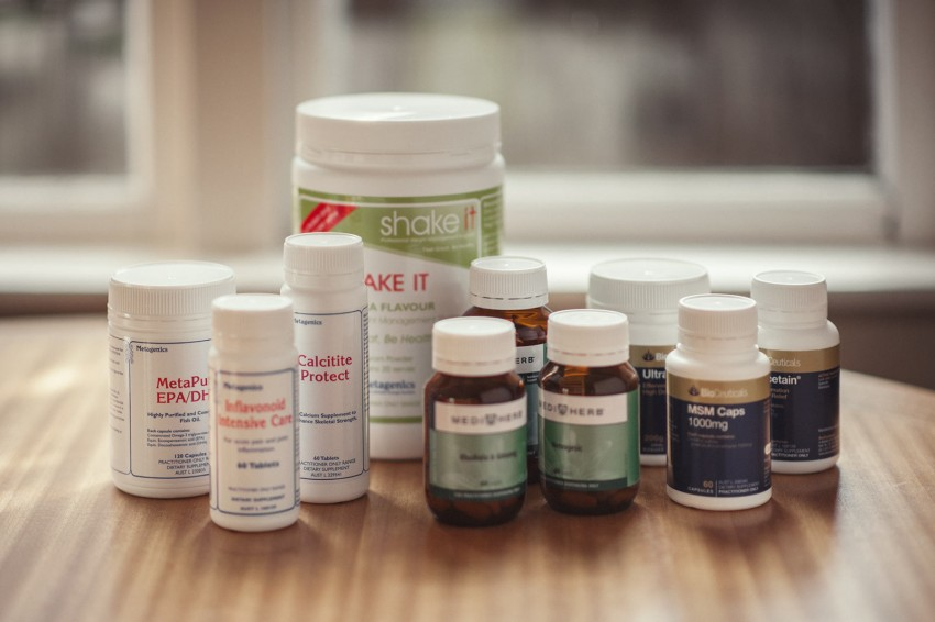 Many various supplements are displayed on a table to show what you can take for sports injury