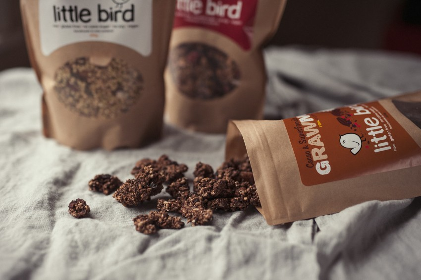 Various Little Bird cereals which make a good protein snack are displayed on a table cloth