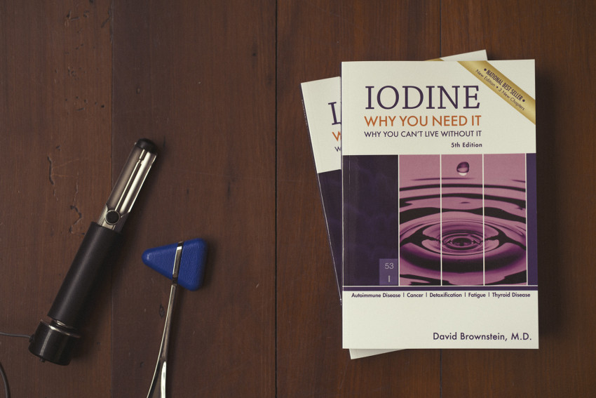 Two copies of Dr Brownstein's wonderful book on iodine deficiency sits on a table