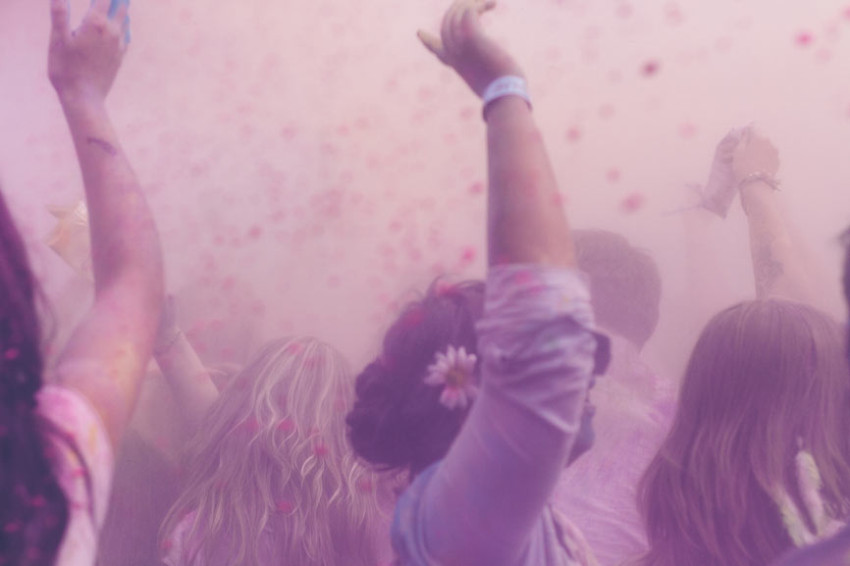 Young girls dance in a purple flowery haze to represent the health benefits of iodine
