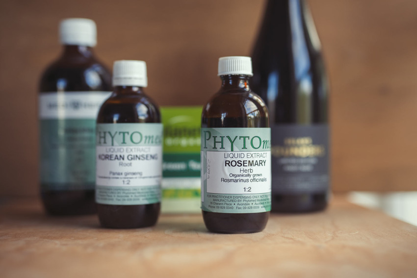 A variety of herbal antioxidants are displayed as well as a bottle of red wine