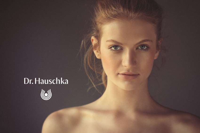 An advert of a pretty young girl to promote Dr Hauschka products