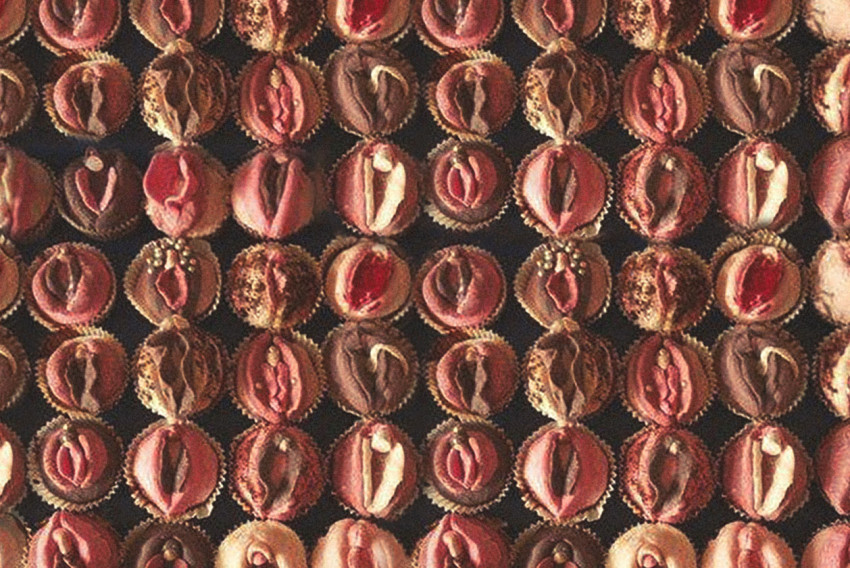 A closely packed display of cupcakes that look like vaginas