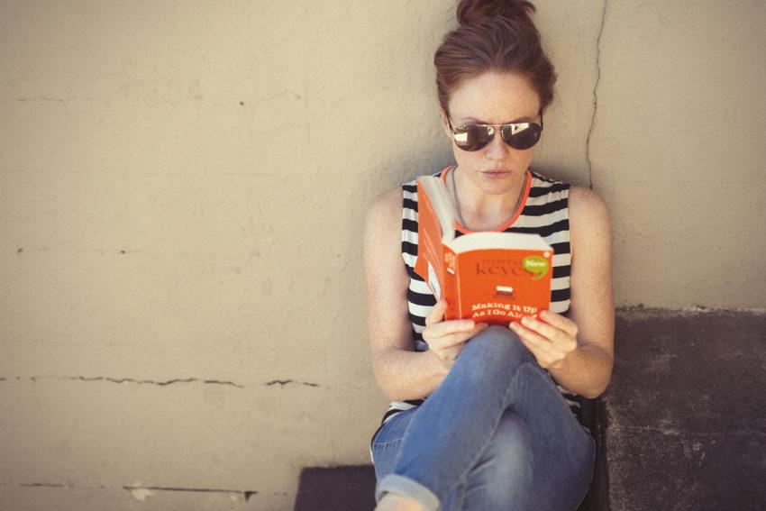 Naturopath Lisa Fitzgibbon feeling healthy reading a novel outside OOMPH