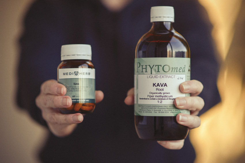 Medical Herbalist Lisa Fitzgibbon holds up a bottle of Kava tablets and a bottle of Kava liquid herb