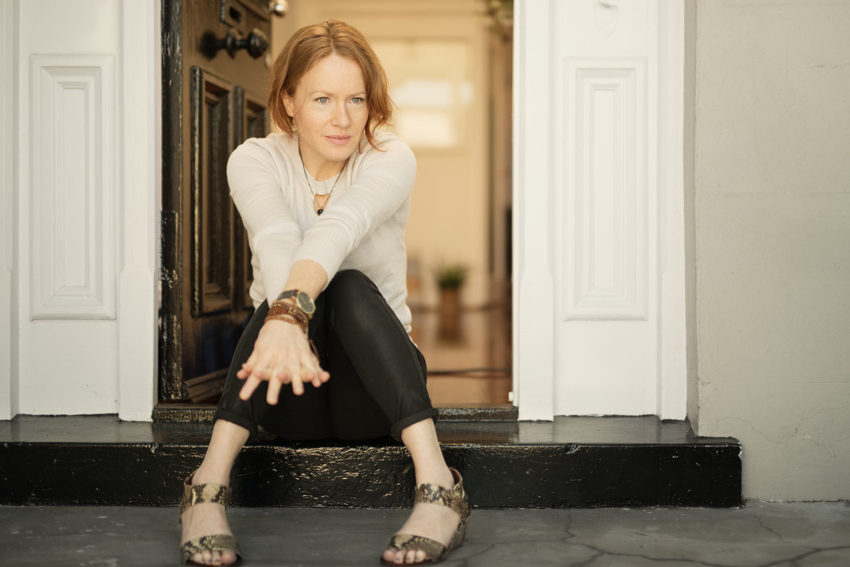 Naturopath Lisa Fitzgibbon sits on her practice's door step she suffers from depression