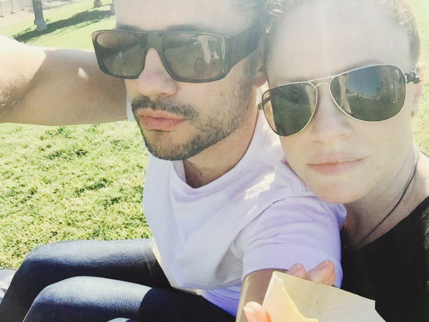 Naturopath Lisa Fitzgibbon and her partner wearing sunglasses and in a healthy romantic relationship