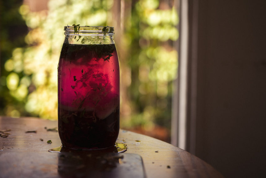 Beetroot Kvass sits in a jar on a table this drink is good for your health