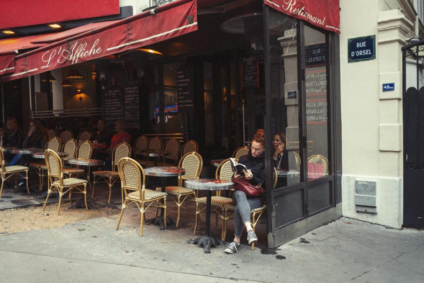 Naturopath Lisa Fitzgibbon sat at a Paris cafe enjoying a minimalist lifestyle