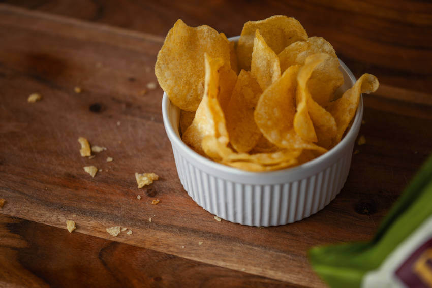 How to overcome behavioural addictions. Use portion control – a serving size bowl of crisps.